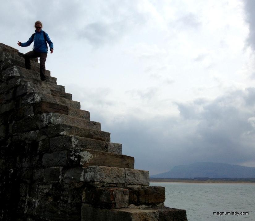 Auriel climbing the cliff wall