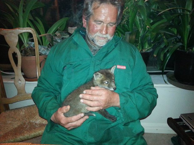 Lothar with a fox that he nursed back to health. Photo by Eagles Flying